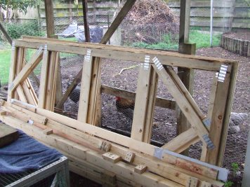These are the pallet-type frames that were found by The Parents-in-law. With some chicken wire and brackets, I think they could help make an excellently cheap chicken tractor. I'm an eager beaver to get my hands stuck into this project.