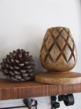 A pinecone, because, if you hadn't noticed, I love pinecones, and a pinecone candle holder, which just needs a little resurfacing.