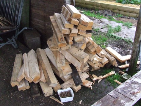 The newest pile: The Husband has been very busy breaking up and removing the massive nails from the sturdy pallets. Now the pieces of wood just need to be cut to fire size.