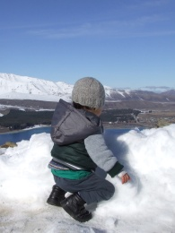 The Little Fulla discovers the joys of snow and how to throw it around, atop Mount John, Tekapo.