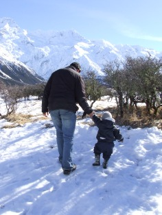 The Husband helps The Little Fulla learn to walk on snow.