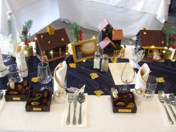 Do you think I love the wedding table settings or what? Each table was the home of a different Sylvanian Family of animals, comprised of hand-painted houses with little street lanterns, handmade holly trees and wee string lights.