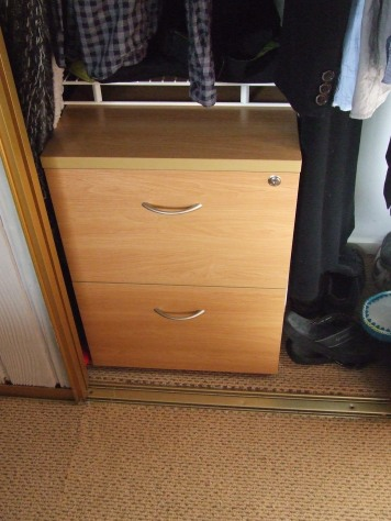 The new filing cabinet just fits into the wardrobe and The Little Fulla can't open it. Ha!