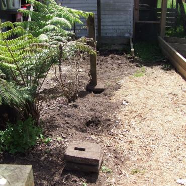 Demolishing a fence and moving things to make more vege beds.