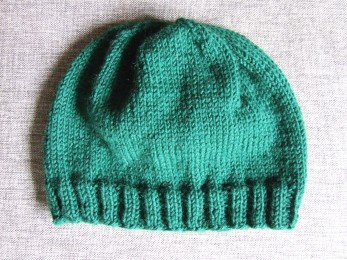 A green hat to go with The Little Fulla's green jersey. I'm pleased to say this did not take 6 months to knit.