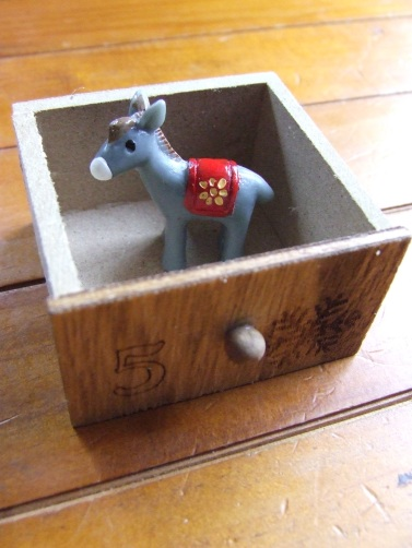 This tiny donkey may have been intended for a fairy garden but now it's a cute nativity calendar piece.