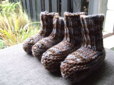 Two sets of slippers for The Little Fulla, because the first ones were a bit small.