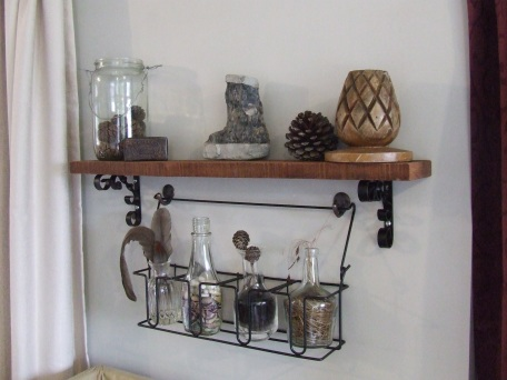 The shelf and metal rack with vases feature I put together.