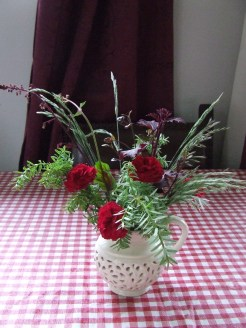 I did a few vases of flowers for the table. I ought to do more this year.