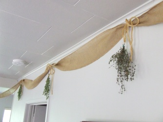 Drying herbs in the lounge.