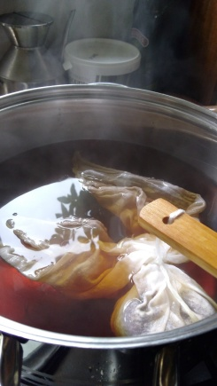 Brewing the kombucha tea: filtered water, sugar and tea.