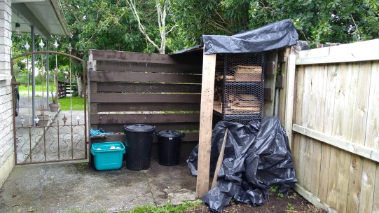 The rubbish corner has never looked so tidy, despite the black plastic. When we do the proper roofing we'll have soome roofing over the bins too.