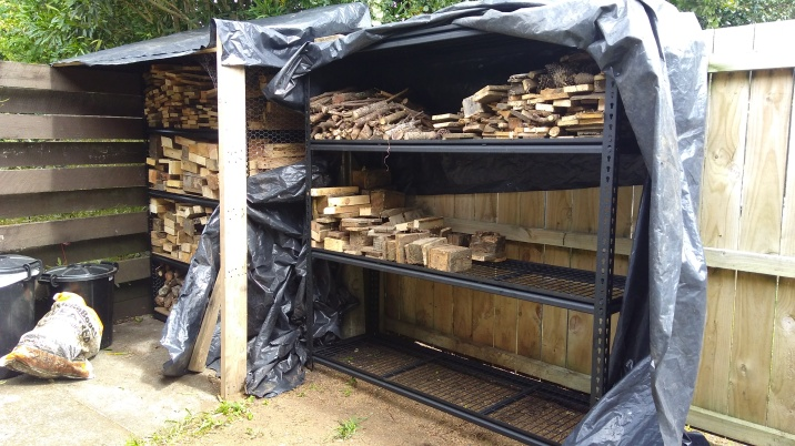 Stacking the firewood in its new home, smaller pieces at the top and bigger pieces at the bottom.