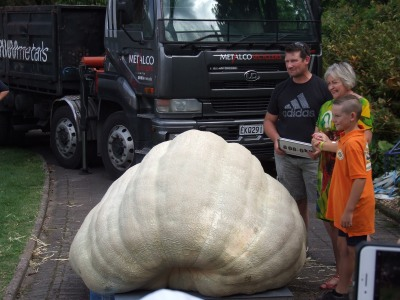 The Pumpking with his son, the mayor and his record-winning 808kg pumpkin.