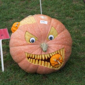 A kinda creepy but skillfully carved pumpkin.