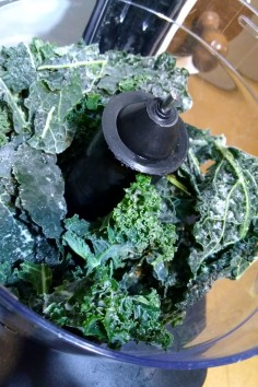Whizzing up frozen kale leaves.