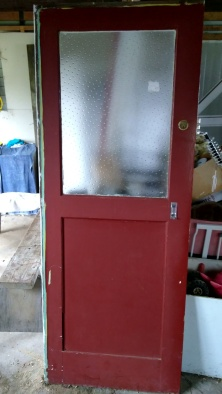This door will let more light into the laundry without breaking the bank. But it needs to be whipped into shape.