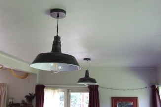 The dining room lights are hanging industrial style lights. There is another one of these to go in the kitchen. The underside of them is a bit too stark white so I will probably spray paint them a cream colour at some point.