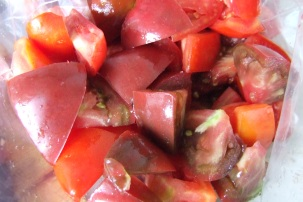 Chopped tomatoes go into the freezer.