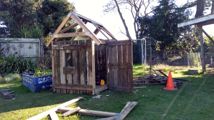 The roof isn't on yet, but The Little Fulla is carting things into his 'wood shed' for storage.