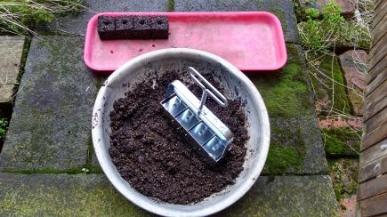 The soil blocker makes a row of four soil blocks at a time.