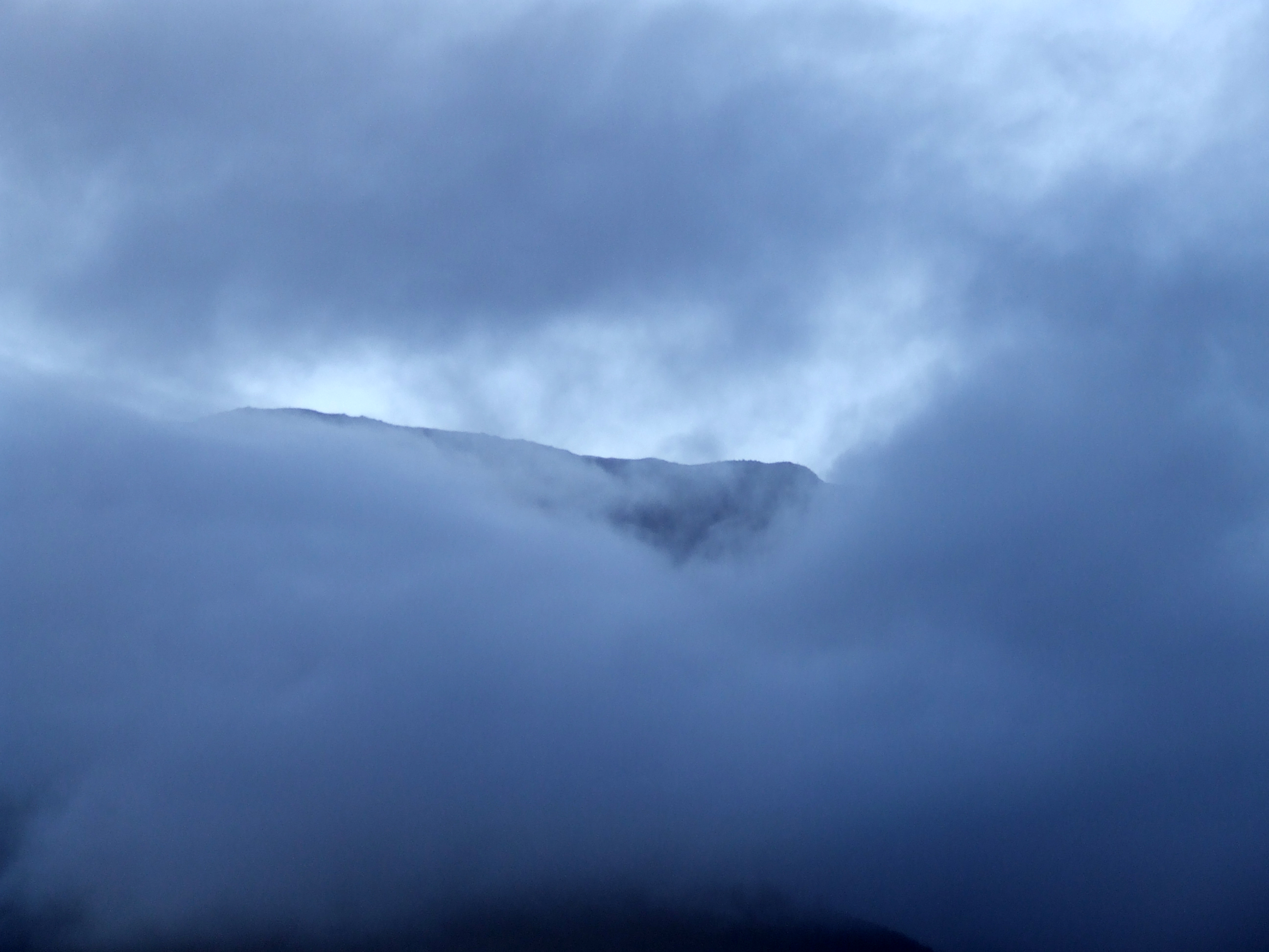 Fog and cloud covering a mountain